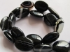 Black Banded agate puffy oval beads