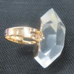Facet rock crystal clear quartz point brass ring